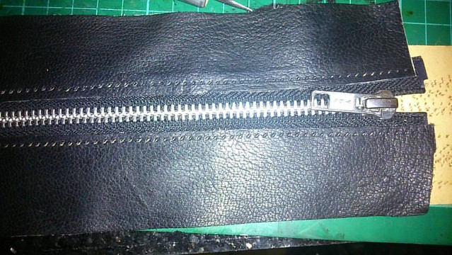 Adding some leather to the zip for my zipped pen case. #pencase #leatherpencase