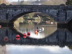 Through an arch of Totnes Bridge