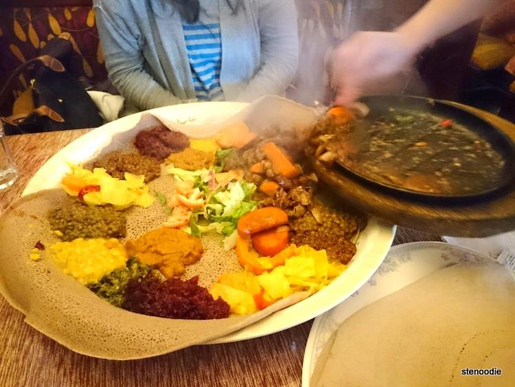 Pushing Zilzil Tibs onto vegetarian platter