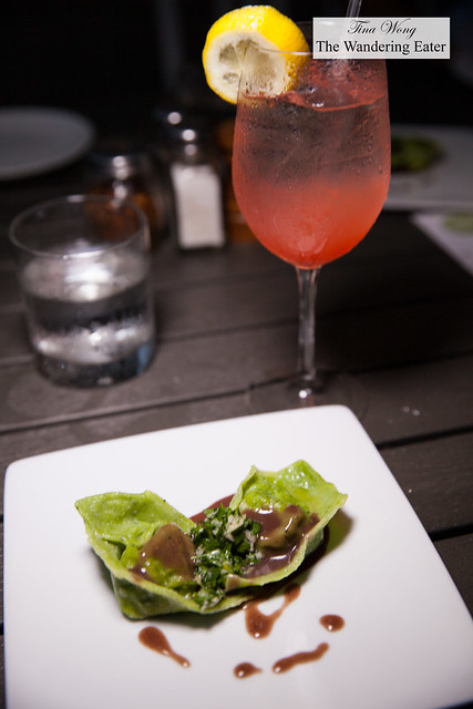 Local arugula ravioli, brasied truffle oxtail served in red wine jus topped with gremolata