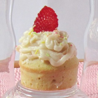 Vanilla cupcakes with butter-cream frosting and Strawberry
