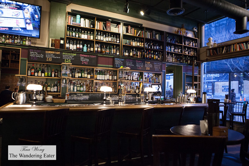 Really cool wall of books and liquor at the bar