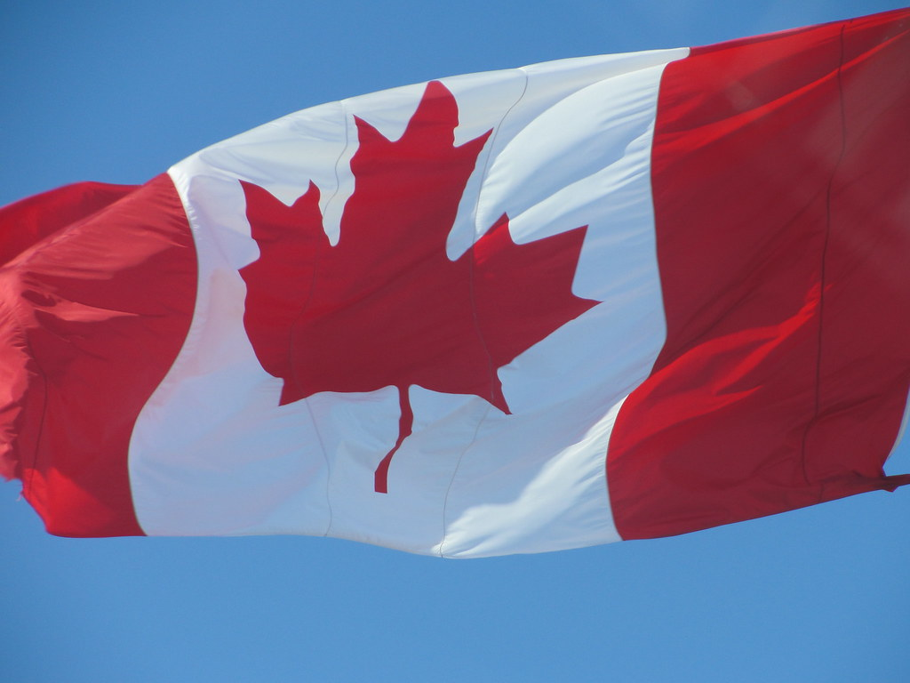 The Canadian flag flyer over the Weber Group building in Kitchener