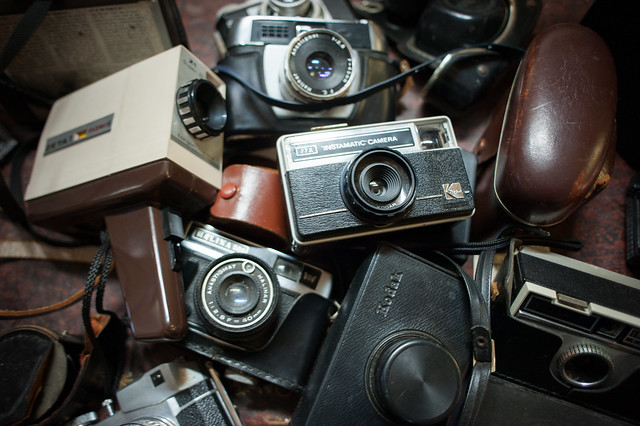 A table full of antique cameras we found while traveling London with Kids