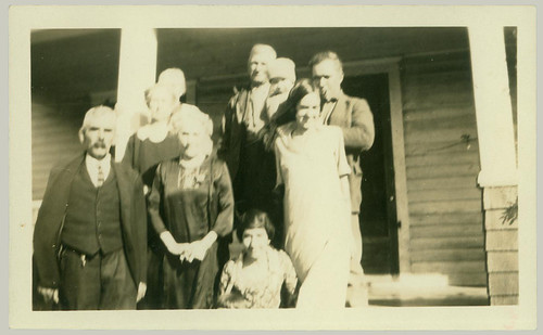Group in front of farm house