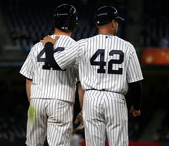 Yankees third-base coach Joe Espada chats with Brett Gardner