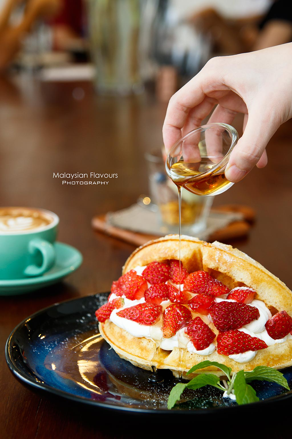 strwaberry waffle with maple syrup