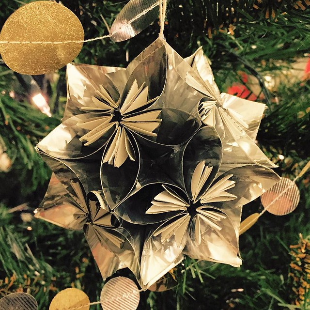 In 2008 we started an annual tradition of making one of these #kusadama ornaments. Last year was the first year we didn't do one, so we made two this year to catch up. This one was made from a mylar coated wrapping paper which made it difficult to assembl