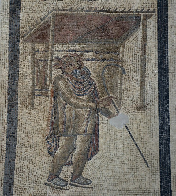Mosaic of a Tragic Actor with a mask on his face giving an oratory, the stage, a four-column aedicula with a flat roof creates a perspective, 2nd century AD, Salón de los Mosaicos (Hall of Mosaics) - Alcazar of the Christian Monarchs, Cordoba, Spain