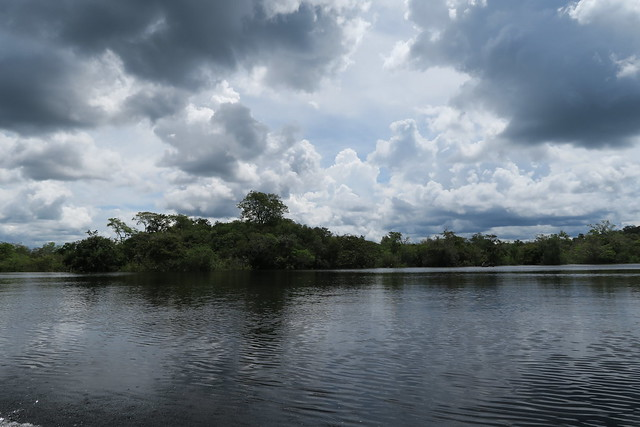 river bank dark cloud amazon tupana river
