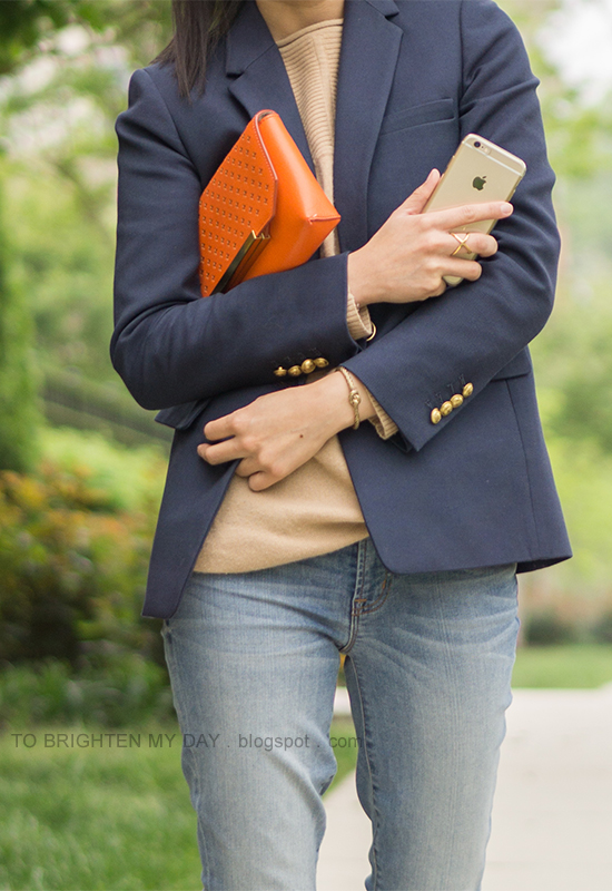 navy blazer, camel sweater tunic, lightwash distressed jeans, orange clutch, gold jewelry
