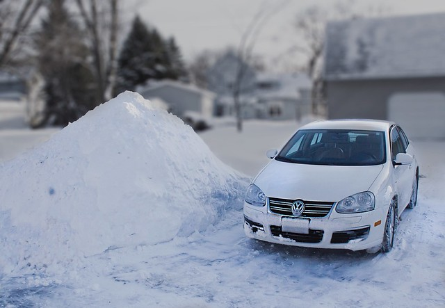 Snow Pile and Car
