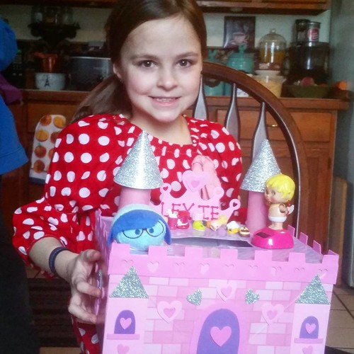 Lexie came home from school with a box full of valentines and a cold. At least it isn't the stomach virus that is making the rounds through her class!!!