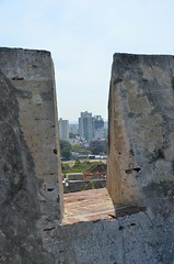 Climbing on the Castillio de San Felipe, Cartagena, Colombia