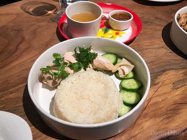 Khao Mun Gai Chicken fat rice, ginger-poached chicken, Pim's secret sauce, served with a cup of chicken broth