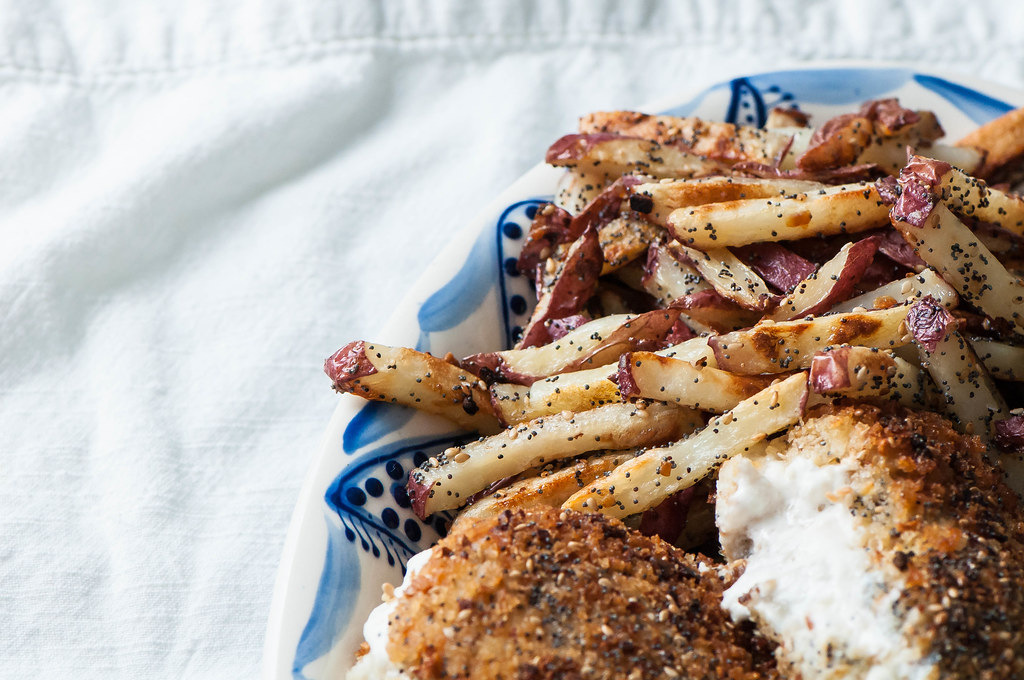 Chicken breaded in all the spices from an everything bagel then stuffed with cream cheese creates the ultimate indulgence. Use that extra seasoning for some baked french fries and you have an entire meal with this Cream Cheese Stuffed Everything Chicken with Everything Fries. Yum!