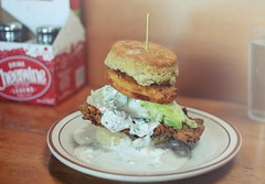 r.e. ~ posted a photo:	My favorite biscuit at Pine State. Fried chicken, fried green tomato, a wedge iceberg lettuce and blue cheese dressing.2204 NE AlbertaPortland, OR 97211