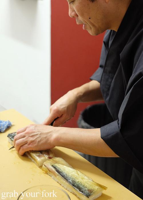Chef Shinji Matsui slicing the saba mackerel bou-sushi at Sashimi Shinsengumi, Crows Nest