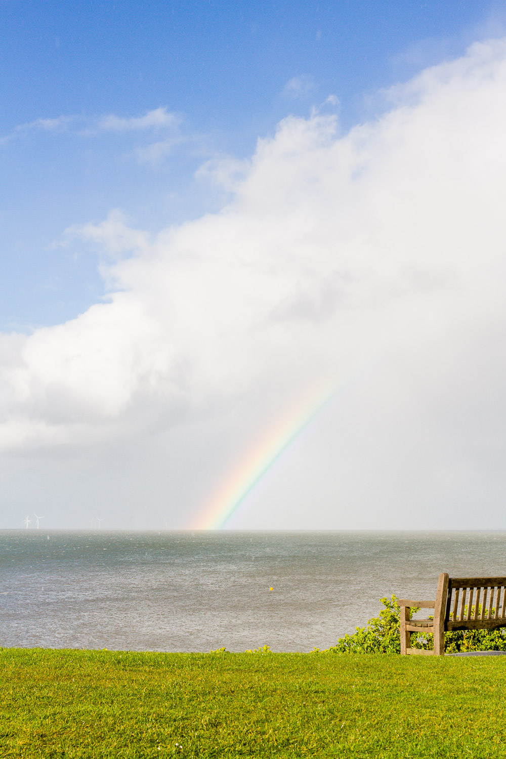 rainbow over the sea coast