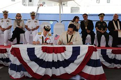 Vice Adm. Nora Tyson, left, commander of U.S. 3rd Fleet, and Leo Herrera-Lim, Philippine Consul General in Los Angeles, sign documents transferring ownership of R/V Melville to the Philippine Navy. (U.S. Navy/MC2 Travis Litke)
