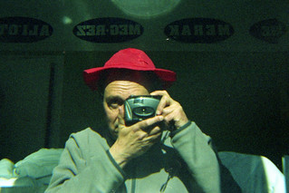 reflected self-portrait with Tele-Wide Outdoor Camera and red hat