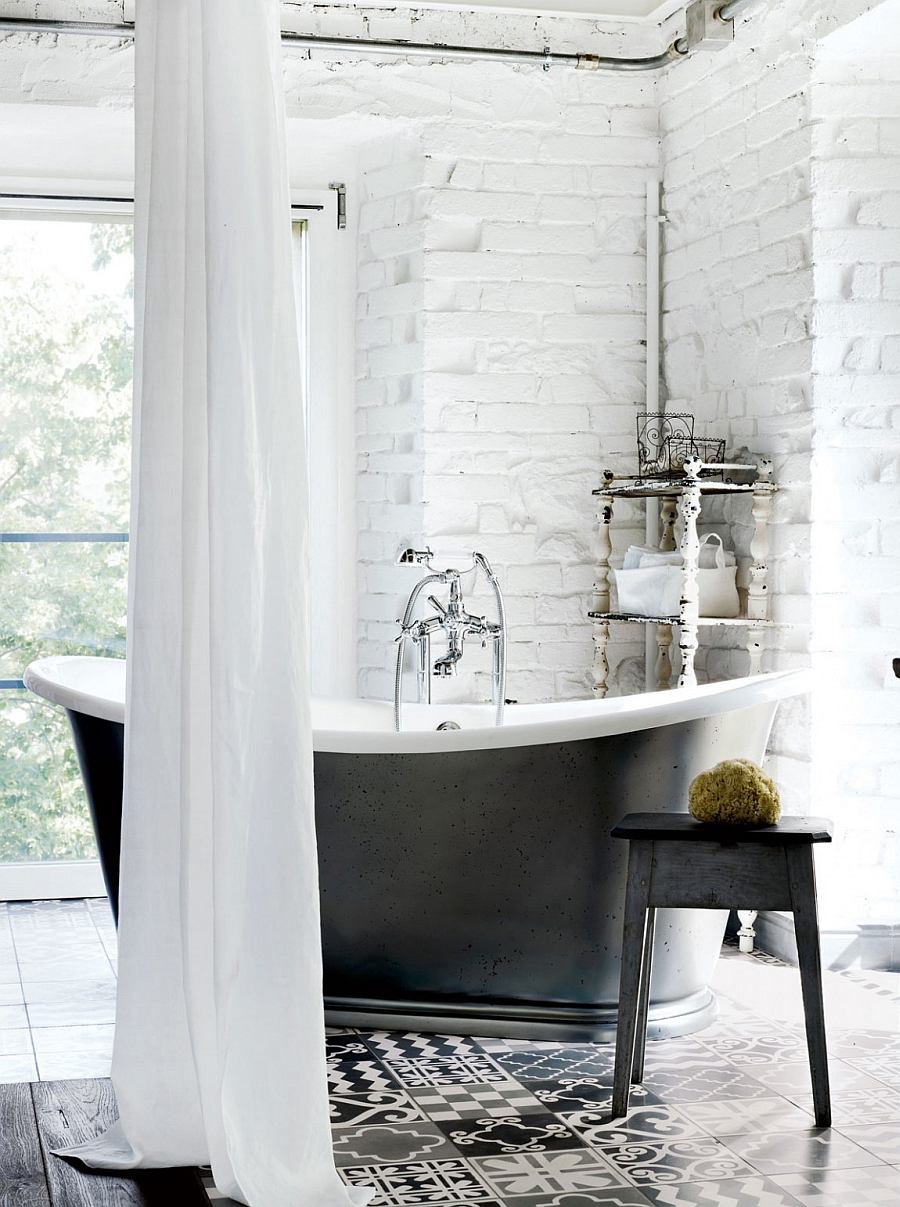 Freestanding-bathtub-in-black-set-against-a-white-brick-wall-in-the-relaxing-bath