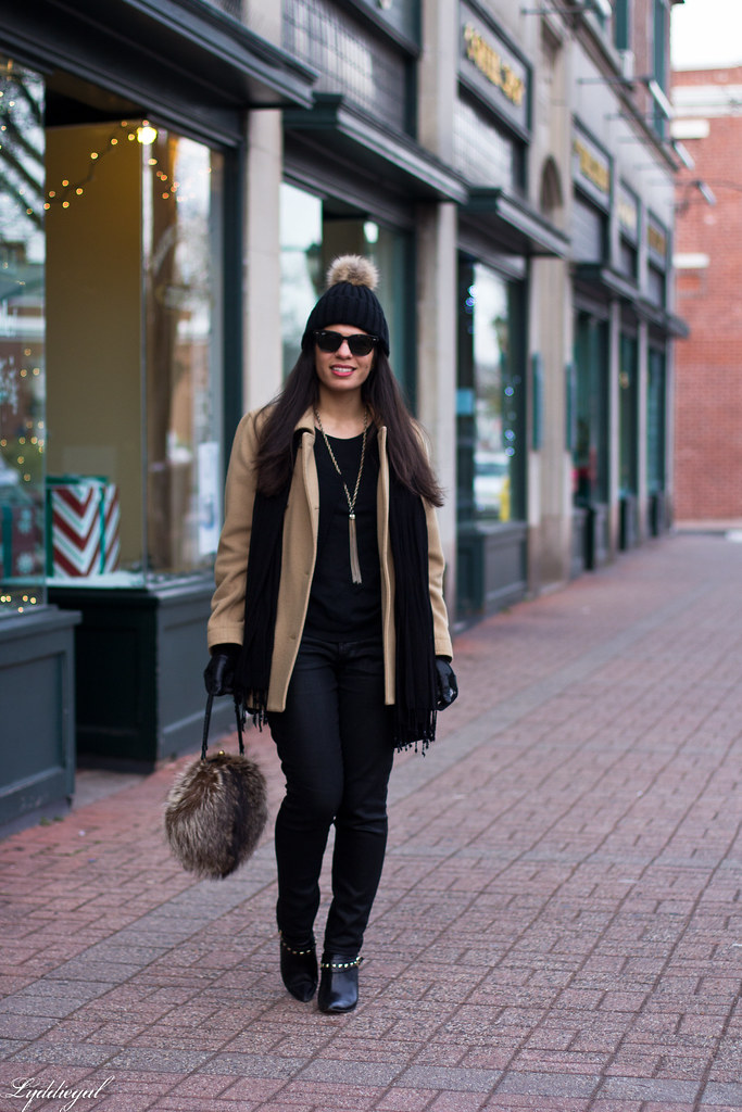 black jeans, black sweater, camel coat, fur pom hat-3.jpg