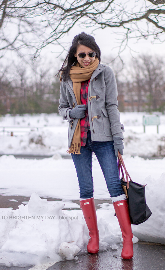 camel scarf, gray toggle coat, red buffalo check shirt, gray gloves, red rain boots
