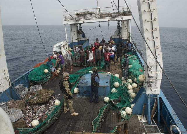 ATLANTIC OCEAN (Feb. 04, 2016) - Members of the Ghanaian Navy and U.S. Coast Guard Tactical Law Enforcement Detachment board a fishing vessel during combined joint boarding operations Feb. 04, 2016. The Military Sealift Command expeditionary fast transport vessel USNS Spearhead (T-EPF 1) is on a scheduled deployment in the U.S. 6th Fleet area of operations to support the international collaborative capacity-building program Africa Partnership Station. (U.S. Navy photo by Mass Communication Specialist 3rd Class Amy M. Ressler/Released)