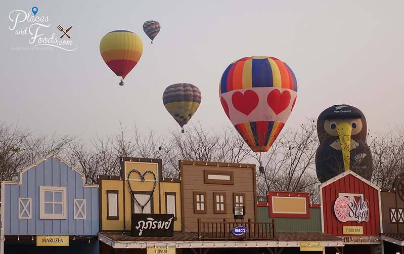 singha park international hot air balloon fiesta balloons on top of shops
