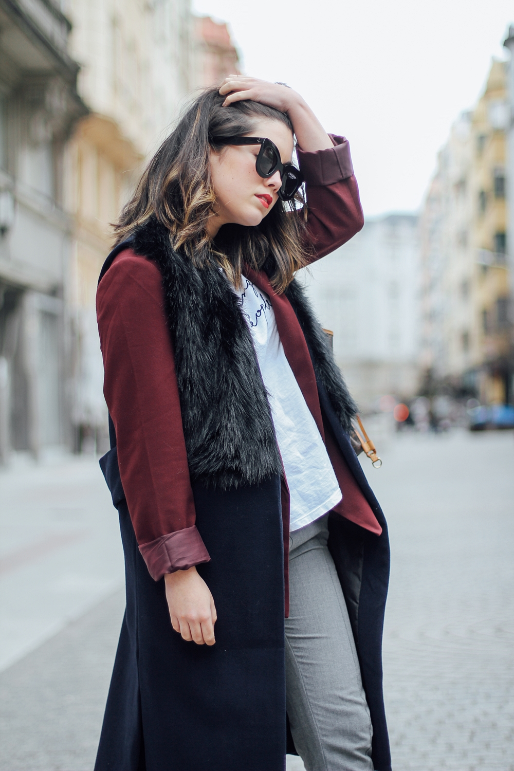 deportivas isabel marant sneakers with faux fur vest and red blazer streetstyle