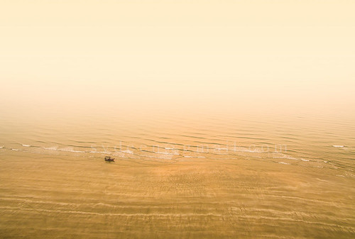morning travel sunset sea summer sky people orange sun reflection beach nature water beauty silhouette fog one boat fishing fisherman sand outdoor dusk dramatic wave scene leisure activity relaxation
