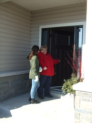 Angela (Angel) Gerard and her daughter Katerina in front of their new home.