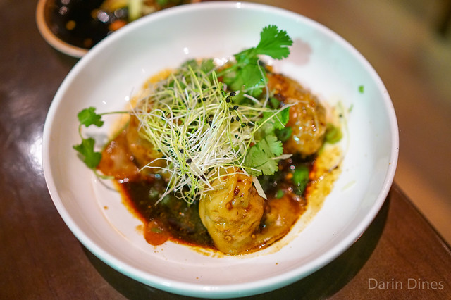 pork, shrimp and crab dumplings, spicy black vin dressing, chives, spinach, peanuts