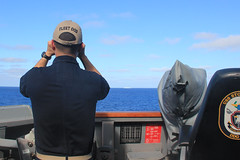 USS Stockdale's (DDG 106) officer of the deck scans the horizon for other surface vessels during a routine patrol in the South China Sea. (U.S. Navy/Ensign Molly Hanna)