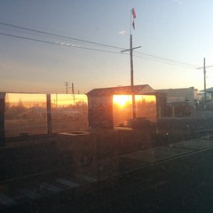 Sunrise through the train & reflections...