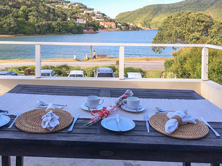 Blick von Amanzi Island Lodge auf Lagune am Morgen