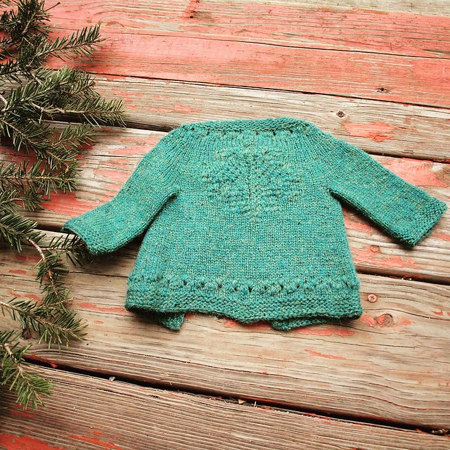 One of my oldest friends (we met in 5th grade!) is now a father, and I knit this wee maple-leaf cardigan for his little girl. Now M wants one in her size! Maybe I'll write a pattern :)