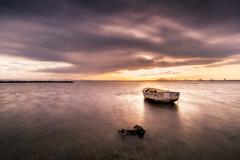 El atardecer y la barca