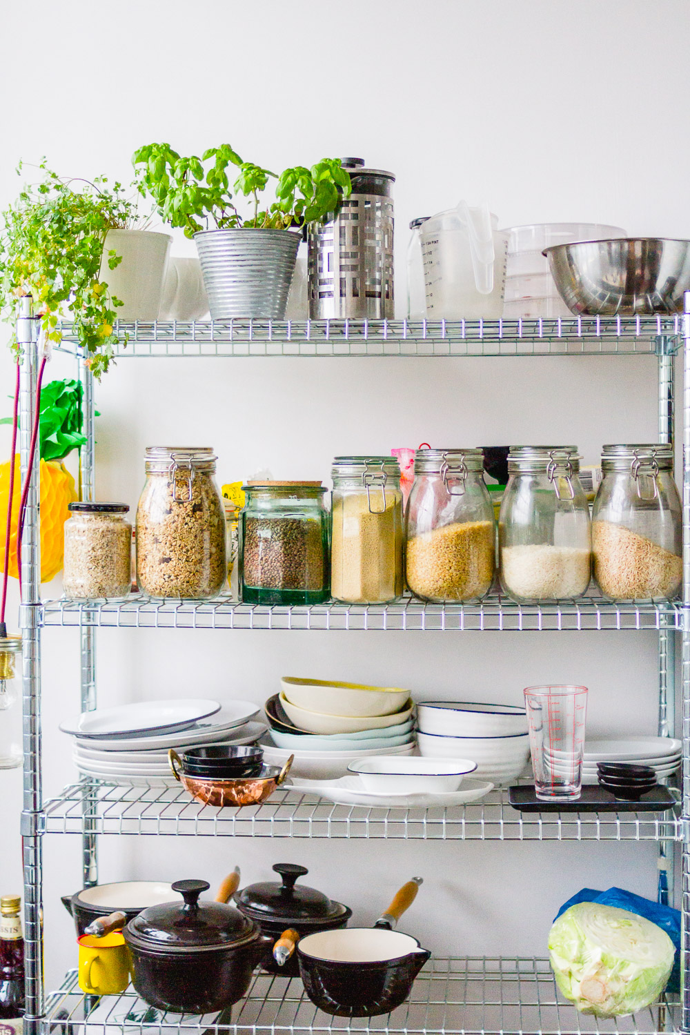 stainless steel shelving unit with glass kilner jars