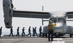 Japan Maritime Self-Defense Force sailors prepare to load supplies onto an MV-22B Osprey aircraft aboard JS Hyuga (DDG 181). (U.S. Navy/MC3 Gabriel B. Kotico)