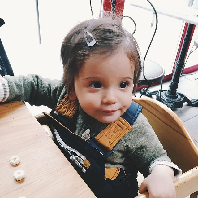 Minutes later, they brought our brunch and this kid was ALL over feeding himself spätzle and sausage. So, weekend tally so far: first real word (cat); a third tooth; and self feeding for the first time. #avigram