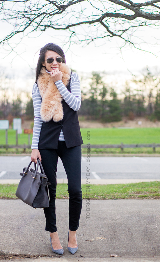 faux fur scarf, gray striped turtleneck, black vest, gray suede pumps