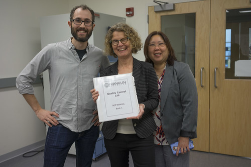 Tue, 2015-11-17 18:45 - Bio-Linkers Jeanette Mowery and Vivian Ngan-Winward standing with David Levin, Pellet script writer and science editor, and holding documentation for our fictional biomanufacturing company, Franklin Biologics