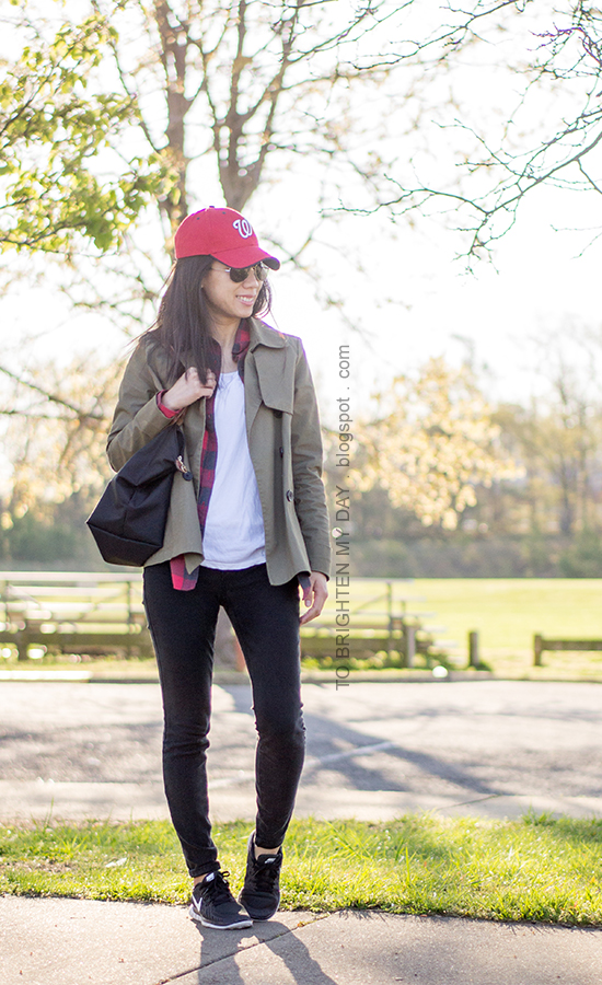 red baseball cap, green swing trench, plaid button up shirt, black sneakers