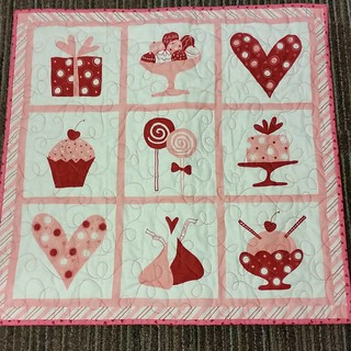 Mikaela and I quilted this one together and I put the binding on. A new wall hanging for my office.