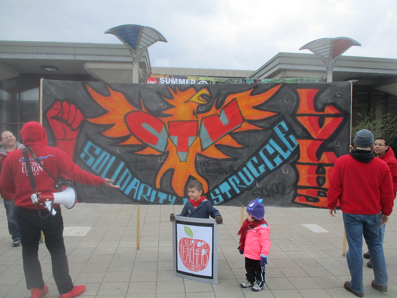 UIC Rally - North Lawndale and Little Village Support CTU banner
