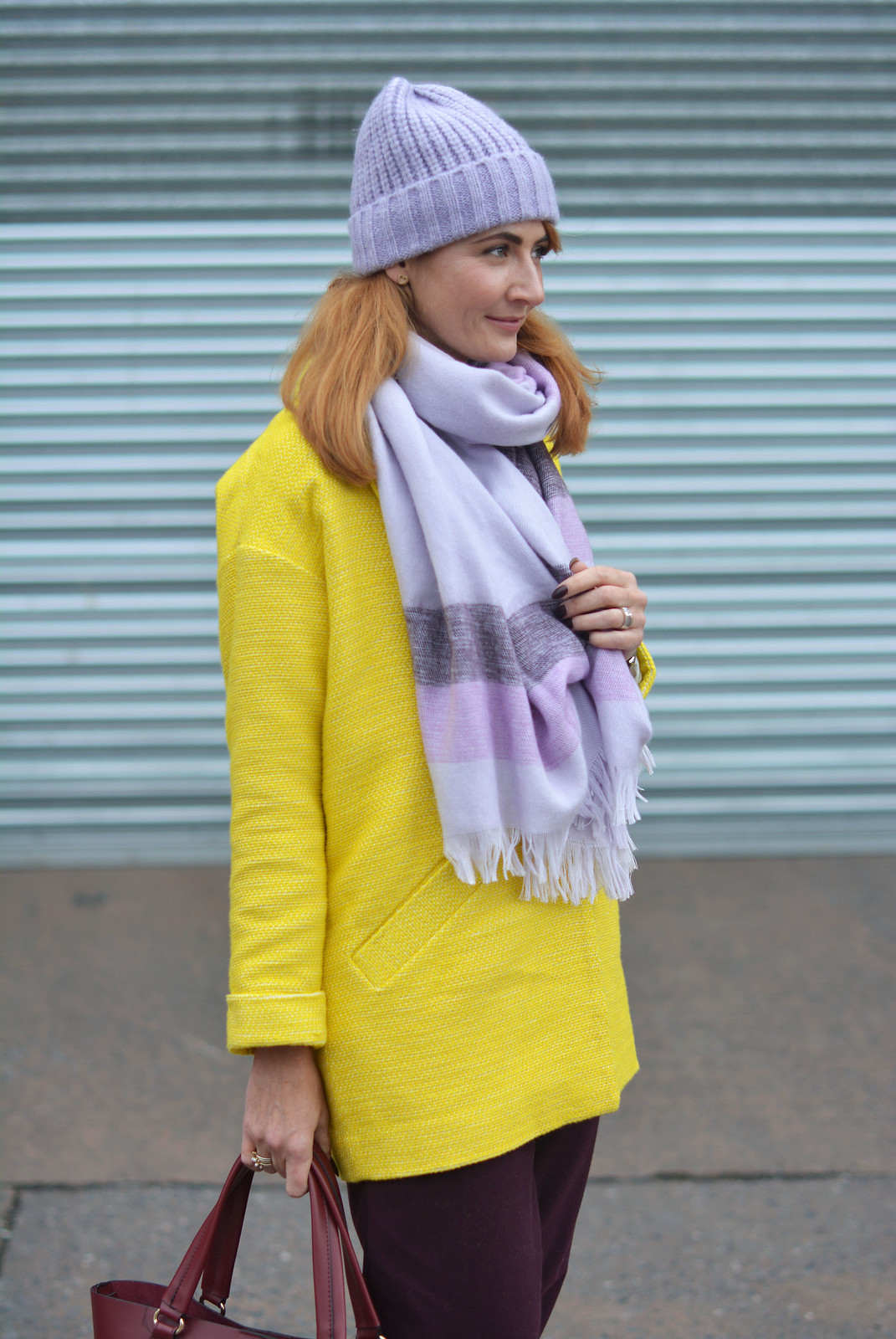 Bright winter outfit | Yellow coat, purple trousers, lilac scarf & hat