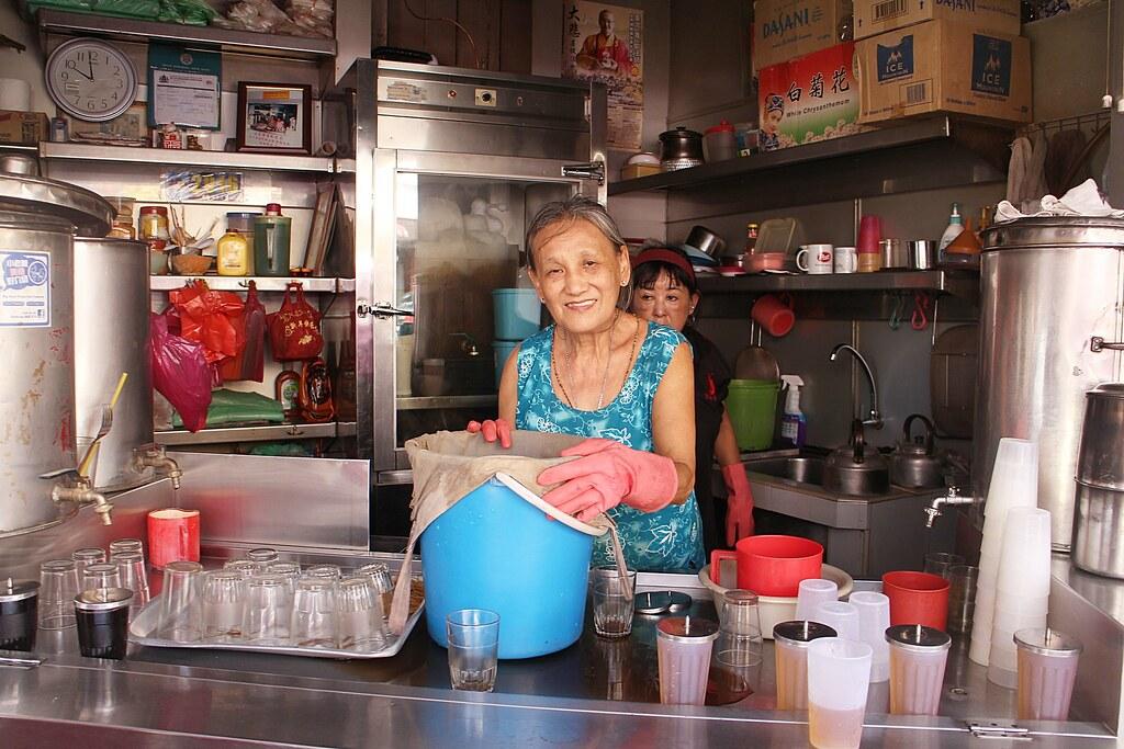 Kow Yow Yong Auntie Preparing Herbal Tea