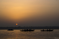 Equinox Sun rising over the holy Ganges in Varanasi